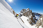 One Man is skiing offpiste from the Peak Cima Groste, Skitour, Brenta Gebirge, Dolomites, Trentino, Italien