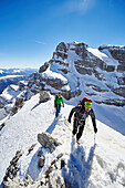 Two men hiking on the peak of Cima Falkner in the backdrop Cima Brenta, Skitour, Brenta Gebirge, Dolomites, Trentino, Italien