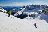 Two men skiing from the peak of Bocchetta die Tres Cime in the Area of the Brenta Dolomites Madonna di Campiglio, Skitour, Brenta Gebirge, Dolomites, Trentino, Italien
