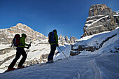 Two Men skitouring in the area of the Brenta Dolomites, Madonna di Campiglio, Brenta Gebirge, Dolomites, Trentino, Italien