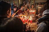 people light incense stick at Man Mo Temple, Hongkong Island, China, Asia