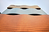 wavy and three coloured fascade of MGM Hotel, modern architecture, Macao, China, Asia
