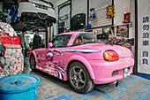 tuning workshop with feminine corny pink car, Macao, China, Asia