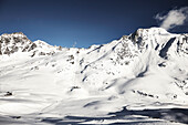 Sunny snowy mountains and ski resort, Schnalstaler Glacier, South Tirol, Italy