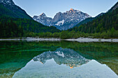 reflection of mountains among them Razor and Prisojnik in alpine lake Jasna, Kranjska Gora, Gorenjska, Triglav National Park, Julian Alps, Slovenia, Europe