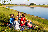 Family having a picnic along the banks of the river Elbe, Family bicycle tour along the river Elbe, adventure, from Torgau to Riesa, Saxony, Germany, Europe