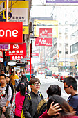 Young man with huge glasses, shopping street, advertisements, street scene, shopping area Causeway Bay, Hong Kong, China, Asia