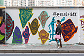 Funny graffiti on wall on Moganshan Road, women passing, street art, Art district at Wusong River, Putuo District, Shanghai, China, Asia