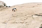 Sport climbing near Xiamen, rock climbing, young man, climbing area Nantaiwu, granite rock, Xiamen, Fujian, China, Asia