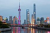historic Waibaidu steel bridge crosses Suzhou Creek, futuristic Pudong skyline in background, Oriental Pearl Tower, Shanghai Tower, Jin Mao Tower, reflections, Oriental Pearl Tower, evening, city lights, Shanghai, China, Asia