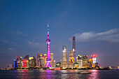 futuristic Pudong skyline in background, Oriental Pearl Tower,  Shanghai Tower, Jin Mao Tower, evening, city lights, Shanghai, China, Asia