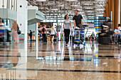 Singapore airport, Changi, passengers, transit, commuters, travellers, modern, trolley, hall, terminal, Singapore, Asia