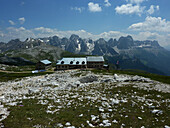 Schlern Houses on Seiser Alp, view to Rosengarten, Dolomites, South Tyrol, Italy