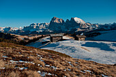 First snow at Seiser Alp, view to Sella, Langkofel and Plattkofel, Dolomites, South Tyrol, Italy