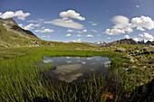 Mountain lake in Stubai Valley, view to the Stubai Alps, Tyrol, Austria