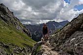 Climbing Mount Peitlerkofel, View to the Geisler Group, Dolomites, South Tyrol, Italy