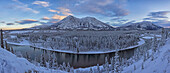 Late winter afternoon light warms up the mountains along the Takhini River, near Whitehorse, Yukon, Canada