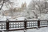 Snow-covered landscape from Oak Bridge, Central Park, New York City, New York, United States of America