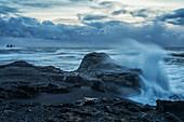 Huge waves crash along the shores of Dyrholaey, along the southern shores of Iceland, Iceland
