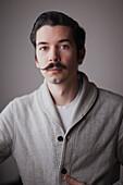 Portrait of a young man with a moustache, Regina, Saskatchewan, Canada