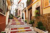 Colourful steps between residential buildings, Altea, Spain