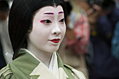 Close up portrait of a Japanese woman in kimono and parade makeup, Kyoto, Japan