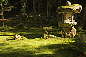 Japanese temple garden with rock lantern and moss, Ohara, Kyoto, Japan