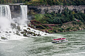 American Falls with the Hornblower tour boat on the Canadian side, Niagara Falls, Ontario, Canada