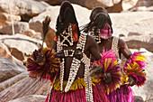 Two people wearing Kananga masks perform at the Dama celebration in Tireli, Mali