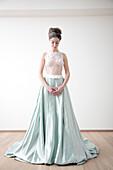 Caucasian bride standing in wedding dress