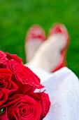 Caucasian bride holding bouquet of flowers