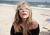 Asian woman wearing eyeglasses on beach