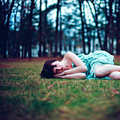 Caucasian woman napping in empty park
