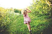 Woman walking in rural orchard