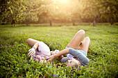 Caucasian women laying in rural field