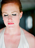 Close up of glamorous bride with eyes closed