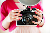 Close up of girl holding camera
