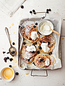 Tray of pancakes with fruit and cream