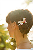 Close up of woman wearing flower in her hair