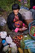 Asian woman smiling at market