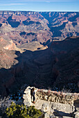 Caucasian woman admiring Grand Canyon, Arizona, United States