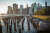 Wooden posts at waterfront, New York, United States
