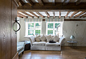 Sofa under beams in living room