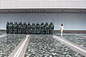 Woman photographs art installation outside Hong Kong Museum of Art, Hong Kong, Hong Kong, Asia