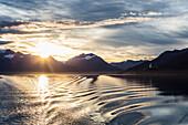 Sunsrise over Valdez Arm from stern deck of M/V Aurora, Prince William Sound, Southcentral Alaska