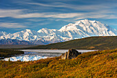 Scenic autumn view of Mt. McKinley and Wonder Lake partially covered with ice, Denali National Park, Interior Alaska