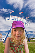 A Young Girl under the World Famous Alaska Highway Sign, Dawson Creek, British Columbia, Canada, Summer