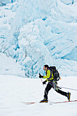 Jeff Benowitz skiing in front of Portage Glacier, Southcentral Alaska, Winter