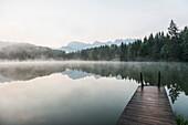 Lake Geroldsee with reflection, Wagenbruechsee, Kruen, near Garmisch-Partenkirchen, Upper Bavaria, Bavaria, Germany