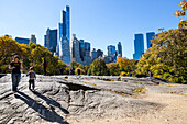 Autumn, fall in Central Park, People walking in the park with the Skyline in the background, Manhattan, New York City, USA, America